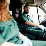 Two medical doctors are driving in their mobile medical clinic van